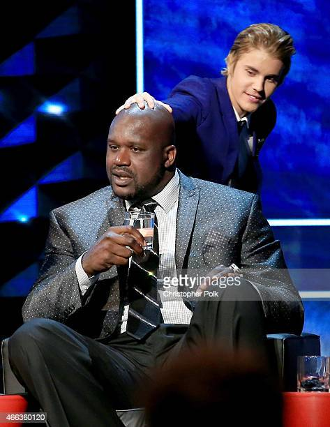 Personality/retired basketball player Shaquille O'Neal and honoree Justin Bieber onstage at The Comedy Central Roast of Justin Bieber at Sony...