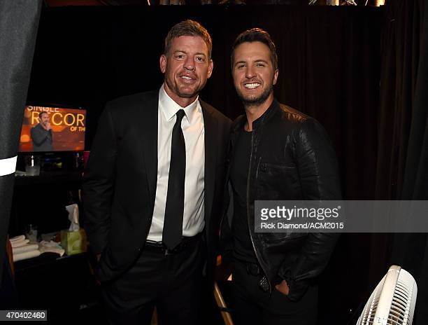 TV personality/retired NFL player Troy Aikman and host Luke Bryan pose backstage at the 50th Academy of Country Music Awards at ATT Stadium on April...