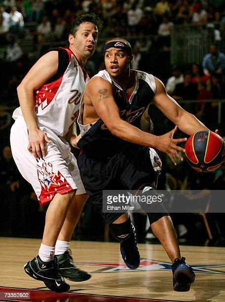 V personality/west team player Tony Potts defends against actor/east team player Donald Fiason during the McDonald's NBA AllStar Celebrity Game...