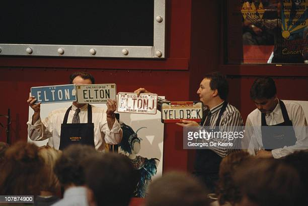 Personalized car number plates belonging to English pop singer Elton John being auctioned at Sotheby's London 6th September 1988