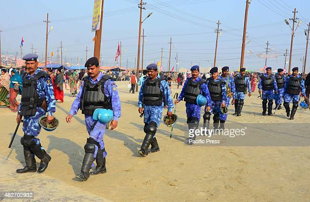 RAF personel patrol as devotees taking holydip on the occasion of 'Maghi Purnima' at Sangam during one month long Magh Mela festival