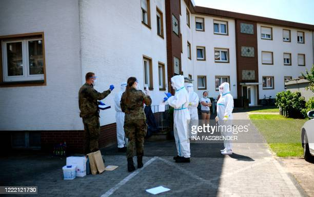 Personell of a mobile testing unit of the German Red Cross and the German army prepare for collecting Covid-19 tests from employees of Toennies...