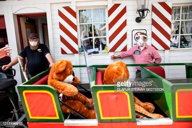 Personell of Tivoli amusement park demonstrates with teddies the social distance strategy during a press conference in Copenhagen on June 4, 2020...