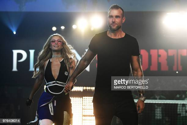 US personnality and model Paris Hilton and German fashion designer Philipp Plein acknowledge the audience at the end of the show of fashion house...