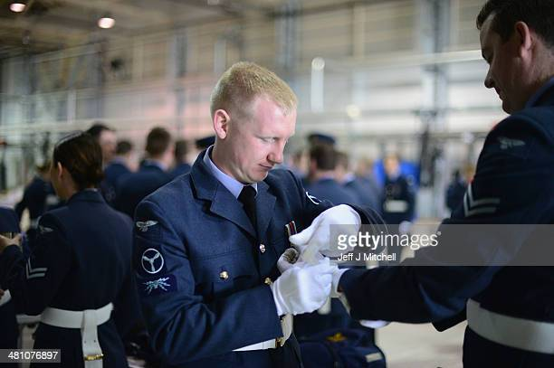 Personnel 617 squadron the Dambusters and their sister squadron 12 prepare to take part in a disbandment parade at RAF Lossiemouth on March 28 2014...
