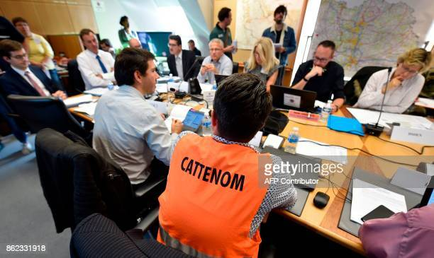 Personnel and officials participate in a simulated nuclear accident exercise at the nuclear power plant of Cattenom at Departmental Operation Centre...