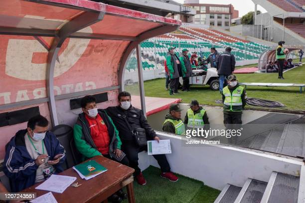 Personnel are obliged to use any type of protection to prevent the expansion of the coronavirus during a match between Bolivar and Wilstermann as...