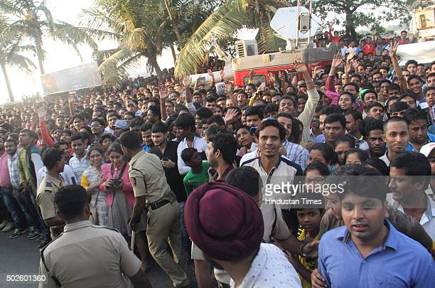 SRPF personnel controlling the heavy crowd of fans gathered outside the Bandra residence of Bollywood actor Salman Khan on his 50th birthday on...