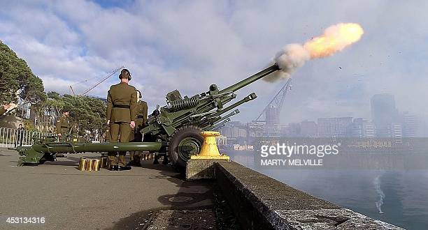 Personnel from 16th Field Regiment of the Royal Regiment of New Zealand Artillery fire ten 105mm Howitzers in a 100gun salute during a ceremony to...