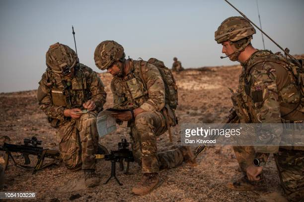 Personnel from 40 Commando, Royal Marines check co-ordinates as they move towards their objective during exercise 'Saif Sareea 3' on October 24, 2018...