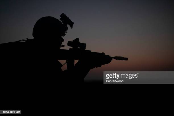 Personnel from 40 Commando, Royal Marines take their positions during exercise 'Saif Sareea 3' on October 24, 2018 in Duqm, Oman. Saif Sareea is the...