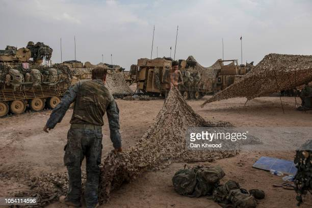 Personnel from D Squadron Household Cavalry prepare to move off from their camp during exercise 'Saif Sareea 3' on October 26 2018 in Oman 2018 has...