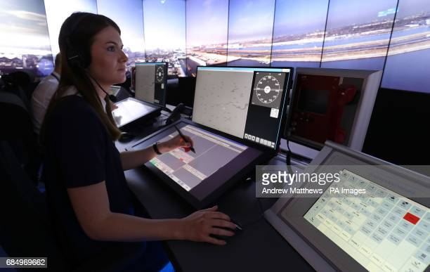 Personnel give a demonstration in the operations room at National Air Traffic Services Swanwick in Hampshire, which will direct aircraft at London...