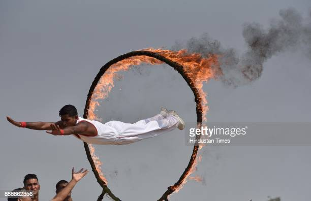 A personnel jumps through fire ring during the celebration of 257th Corps Day of Army Service Corps at Agram ground on December 9 2017 in Bengaluru...