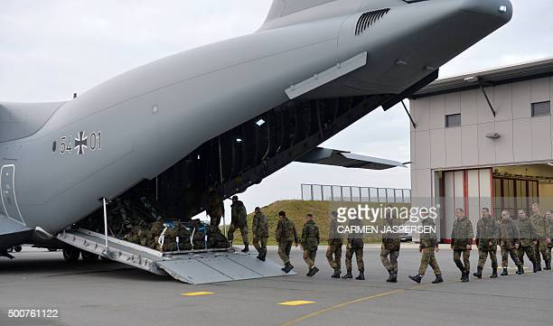 Personnel of the 51st squadron Immelmann enter an Airbus A400M military aircraft before taking off from the German army Bundeswehr airbase in Jagel...