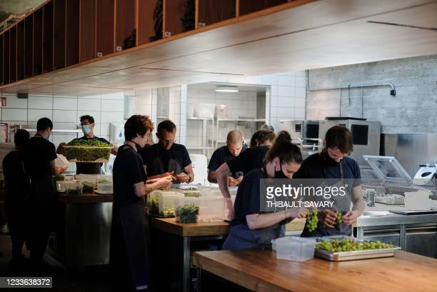 Personnel of the World class Danish restaurant Noma works in the kichten on May 31, 2021 in Copenhagen. - While the six-month Covid-19 closure has...