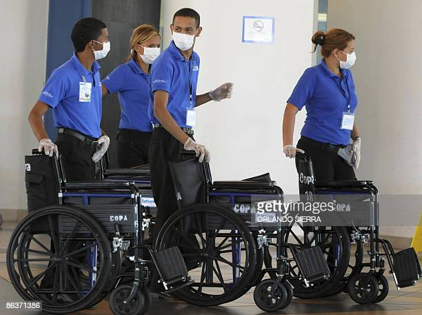 Personnel of Tocumen International Airport in Panama wearing face masks to prevent influenza A wait for passengers on May 04 2009 Mexico was...