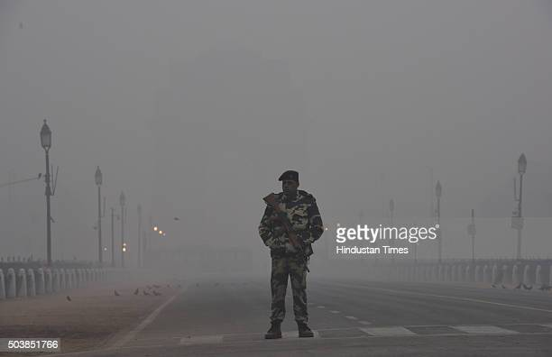 CRPF personnel on duty on a foggy winter morning at Rajpath on January 7 2016 in New Delhi India