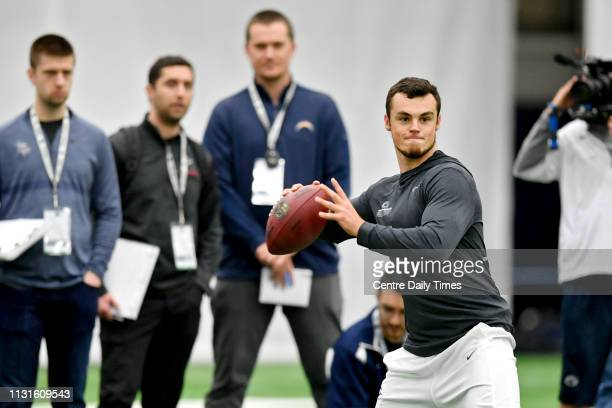 NFL personnel watch as Trace McSorley throws during Pro day on Tuesday March 19 2019 at Holuba Hall in State College Pa