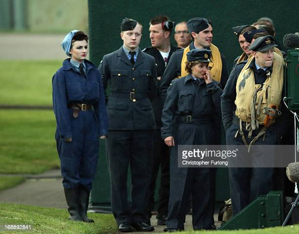 RAF personnell in period costume take part in a Sunset Ceremony to mark the 70th anniversary of the World War II Dambusters mission at RAF Sccampton...