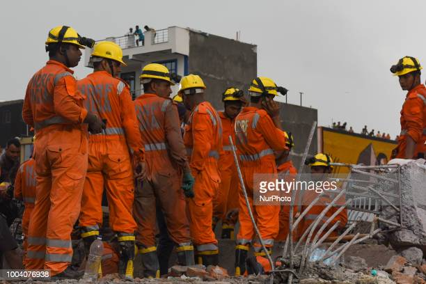 Personnels from National Disaster Response Force conducts a rescue operation after a under construction building collapsed in Dasna Ghaziabad...