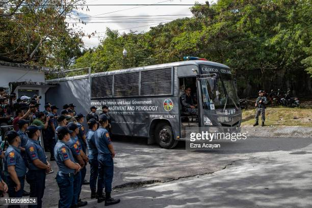 Persons accused in the Ampatuan Massacre are transported in a prison bus following court proceedings in Camp Bagong Diwa on December 19, 2019 in...