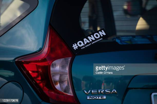 Person's car references the Q-Anon conspiracy theory identified by the FBI as a domestic terror threat before a campaign rally for U.S. President...