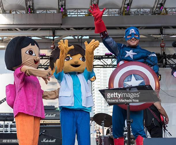 SQUARE TORONTO ONTARIO CANADA Persons dressed as cartoon and gaming characters standing on stage waving at the crowd at MexFest 2015 in Toronto...