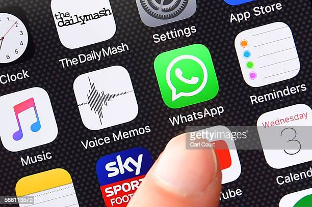 A persons finger is posed next to the Whatsapp app logo on an iPhone on August 3 2016 in London England