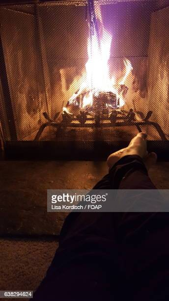 Person's foot in front of fireplace