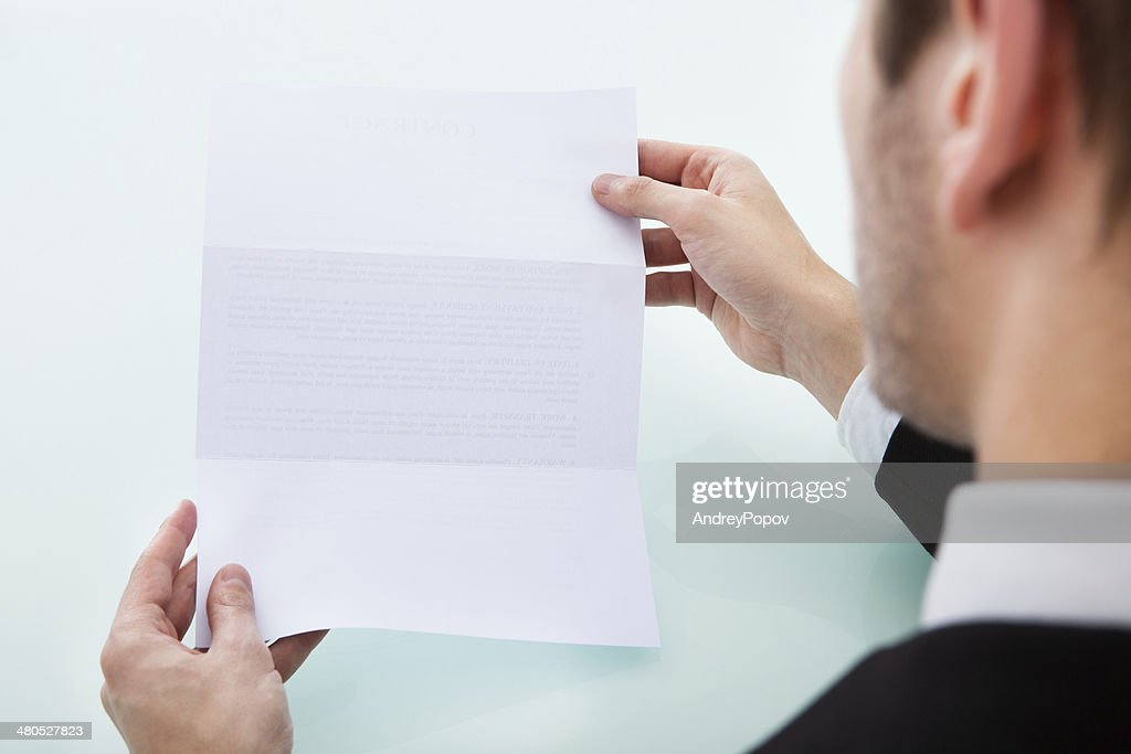 Person's Hand Holding Blank Paper : Stock Photo