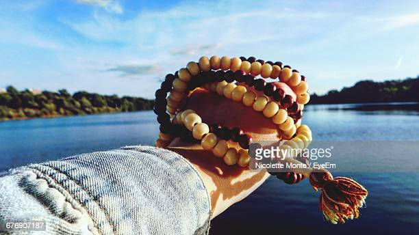 Persons Hand Holding Prayer Beads