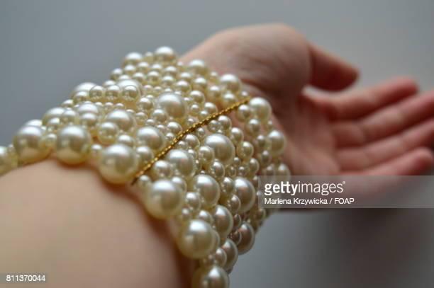 Person's hand wearing bracelet