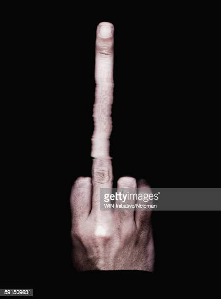 Persons hand with a long middle finger