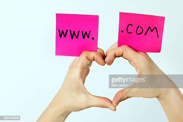 persons hands in the form of a heart - www images com stock photos and pictures