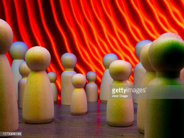 persons represented by wooden figures. in the background dangerous red lines. - family politics stock pictures, royalty-free photos & images