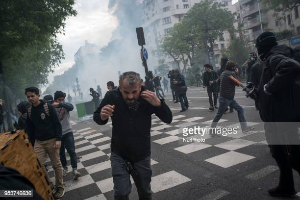 Persons running awy from clashes between Black Blocs and French policemen Thousands of persons between 20 000 and 55 000 have gathered in the Streets...