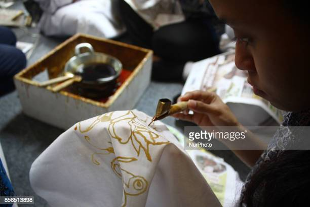 Persons with disabilities attend batik training in order to commemorate National Batik Day at Palbatu Houseof Batik South Jakarta on Monday October...