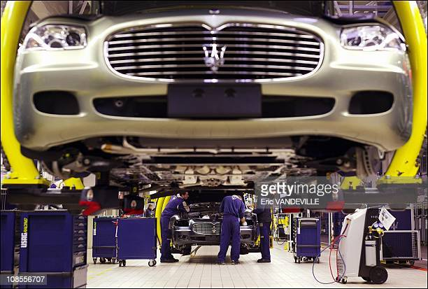 Persons work on the state-of-the-art Maserati assembly line, cars are built in 13 stages. At the end of the line, cars are personalized to meet the...