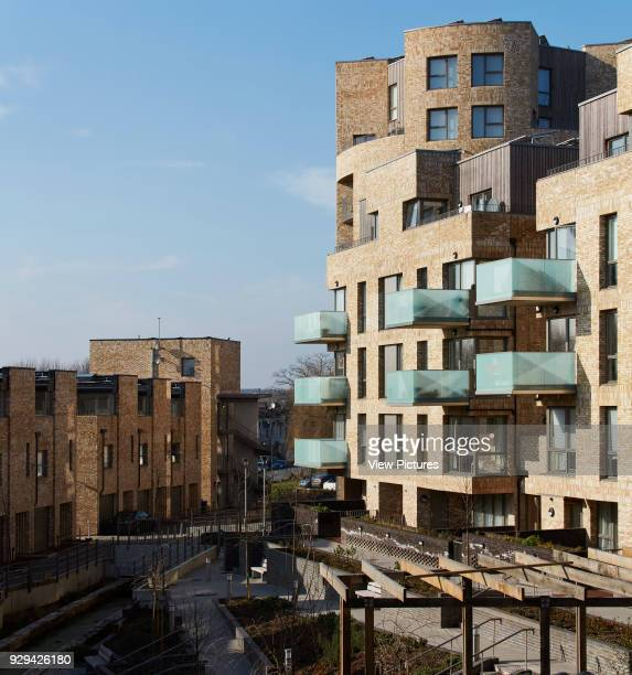 Perspective across communal garden mews terrace and villa apartments Stonebridge Park London United Kingdom Architect Cullinan Studio 2016