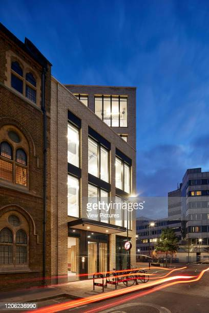 Perspective along historic church facade and modern new building. Paul Street, London, United Kingdom. Architect: Stiff + Trevillion Architects, 2018.