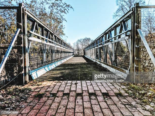 perspective shot of footbridge - diminishing perspective stock pictures, royalty-free photos & images