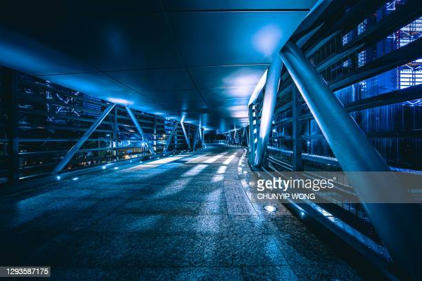 perspective view of a modern closed bridge - bridge built structure stock pictures, royalty-free photos & images
