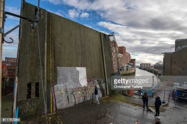 Perspex covers the Banksy graffiti art that was on a disused drawbridge after it was defaced on January 29 2018 in Hull England Banksy appeared to...