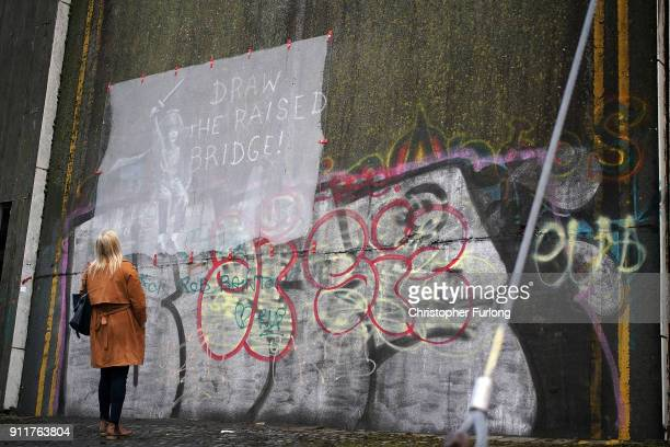 Perspex now covers the Banksy graffiti art on a disused drawbridge after it was defaced on January 29 2018 in Hull England Banksy appeared to confirm...