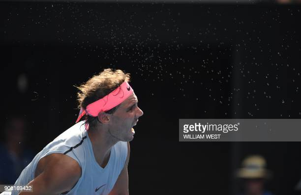 Perspiration drips from Spain's Rafael Nadal as he plays Argentina's Diego Schwartzman during their men's singles fourth round match on day seven of...