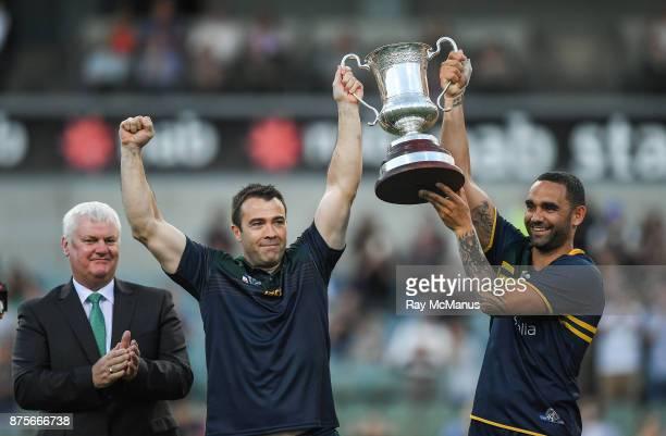 Perth Australia 18 November 2017 Australian manager Chris Scott left and captain Shaun Burgoyne lift Cormac McAnallen Cup as Uachtarán Chumann...