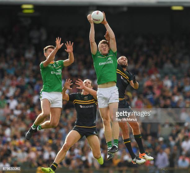 Perth Australia 18 November 2017 Kevin Feely of Ireland wins the ball from teammate Niall Grimley and Nat Fyfe and Rory Laird of Australia during the...
