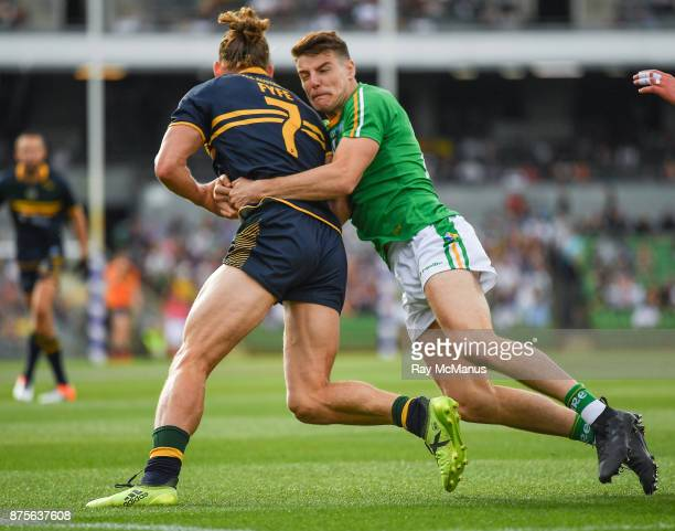 Perth Australia 18 November 2017 Nat Fyfe of Australia is tackled by Niall Grimley of Ireland during the Virgin Australia International Rules Series...