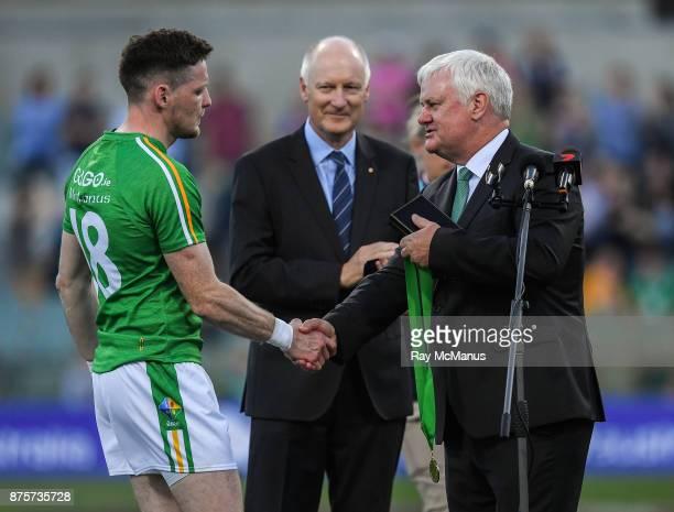 Perth Australia 18 November 2017 Uachtarán Chumann Lúthchleas Gael Aogán Ó Fearghail presents the 'Irish player of the series' award to Conor McManus...